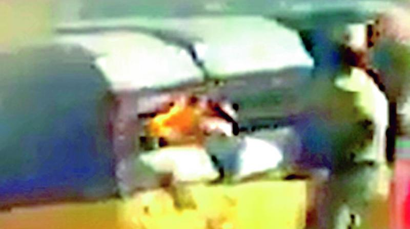 In this clip of a video that has gone viral, a policeman is seen setting an autorickshaw on fire in Mylapore.