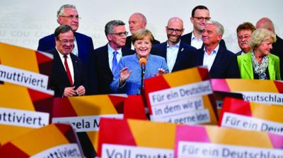 German Chancellor Angela Merkel won a fourth term on Sunday, but now faces the tricky prospect of forming a coalition with two disparate new partners.