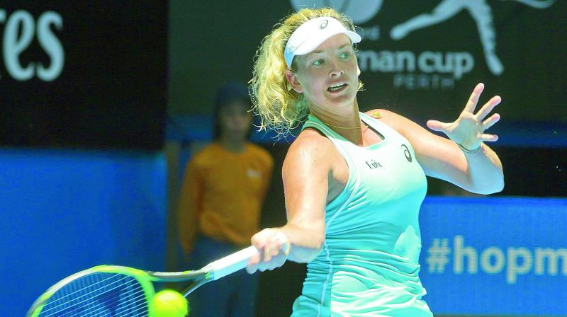 US' Coco Vandeweghe hits a return against Anastasia Pavlyuchenkova of Russia during their women's singles match of the Hopman Cup tennis tournament in Perth on Saturday. CoCo won 6-3, 6-3. (Photo: AFP)