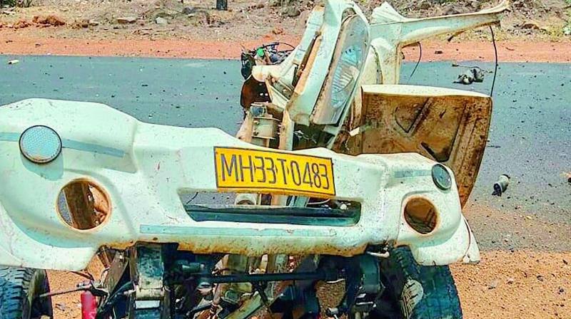 Mangled remains of a police vehicle that was blown up by the Maoists in Gadchiroli on Wednesday.  (PTI)