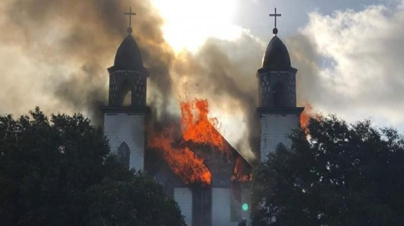 Photos posted on the Austin Catholic diocesan Facebook page show the Church of the Visitation in Westphalia fully involved in flames Monday morning, being reduced to nothing more than ashes. (Photo: Facebook)