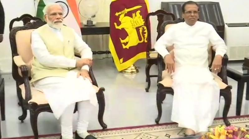 Prime Minister Modi's entourage made a detour to the Catholic church in Colombo on their way to the Presidential Secretariat for official engagements. (Photo: ANI)