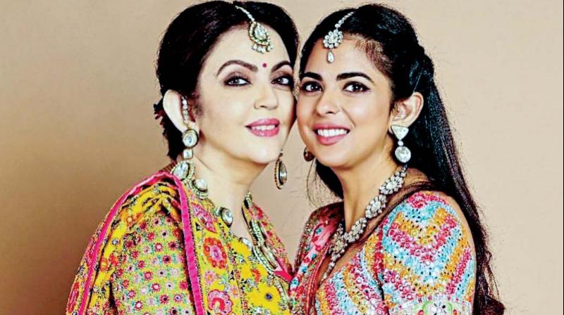 A picture of the soon-to-be bride Isha Ambani with her mother, Nita Ambani, both dressed in Gujarati style attires for the evening has surfaced.