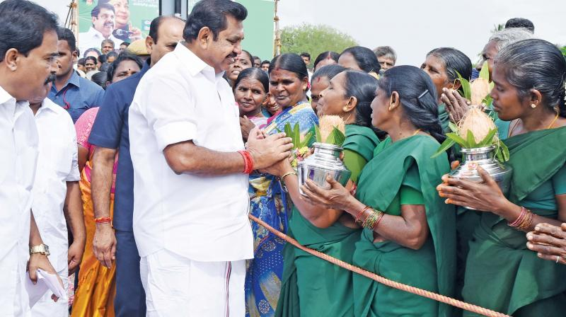 Chief Minister Edappadi K Palaniswami being greeted by women folk at a village near Salem. (Photo: DC)