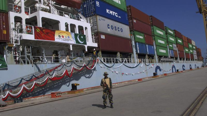 A Pakistan Navy soldier stands guard while a loaded Chinese ship prepares to depart at Gwadar port (Photo: AP)