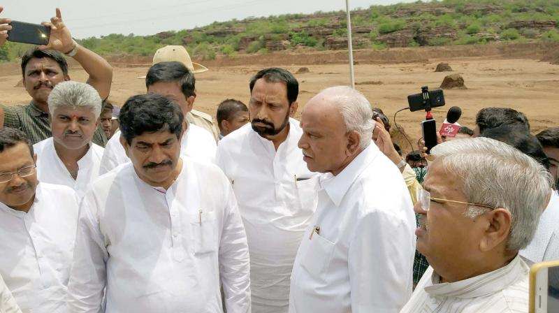 B.S. Yeddyurappa visits drought-hit areas in Bagalkote district. He was accompanied by party leaders including Bagalkote BJP MP Gaddigoudar.