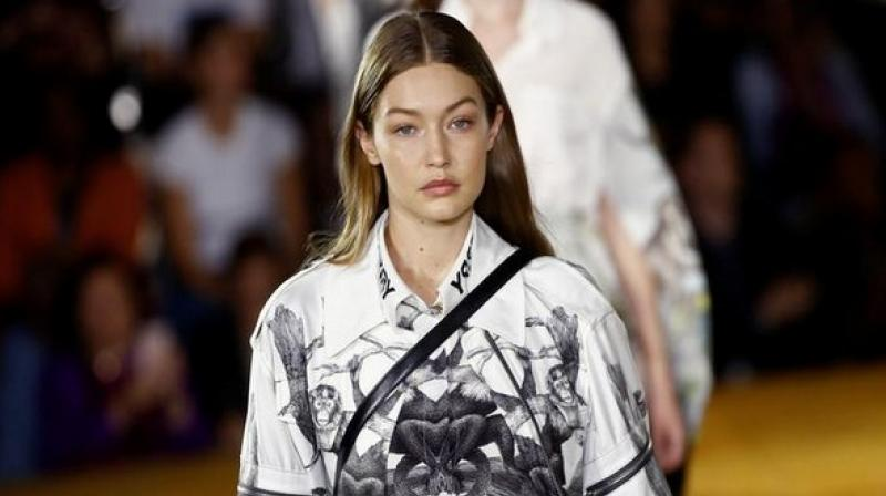 Gigi Hadid blocked French YouTuber Marie Benoliel and escorted her from the runway. (Photo: ANI)