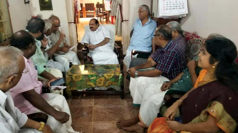 CPM state secretary Kodiyeri Balakrishnan interacts with members of a family during the party's house visit programme in Thiruvananthapuram on Tuesday. (Photo: By arrangement)