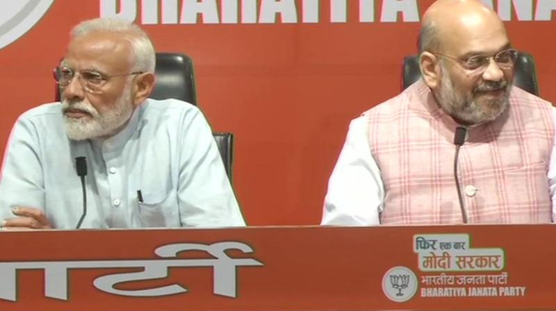 PM Narendra Modi and BJP chief Amit Shah addressing the press conference. (Photo: ANI)