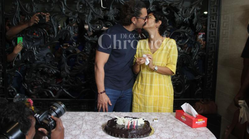 Aamir Khan and Kiran Rao at the superstar's birthday celebrations with the media.