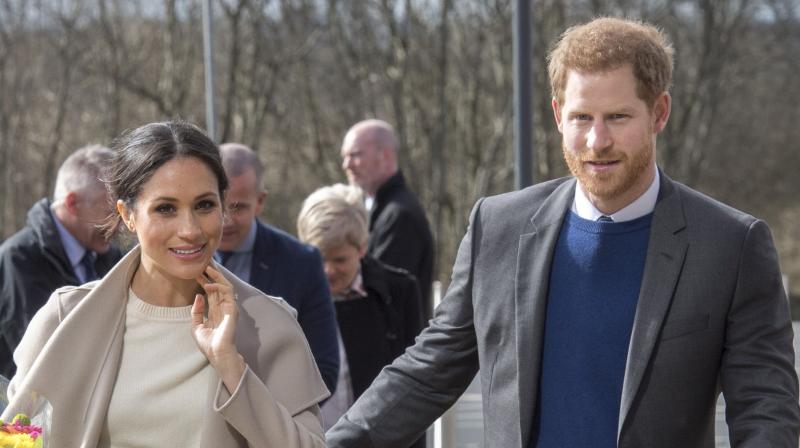 Britain's Prince Harry and US actress and fiancee of Britain's Prince Harry Meghan Markle arrive at the Eikon Centre in Lisburn, on March 23, 2018, to attend an event to mark the second year of youth-led peace-building initiative Amazing the Space. (Photo: AFP)