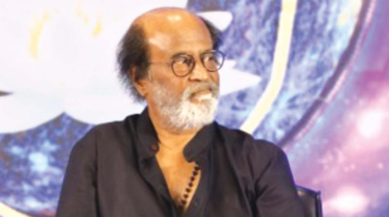 Fall at your parents' feet, not mine: Rajinikanth