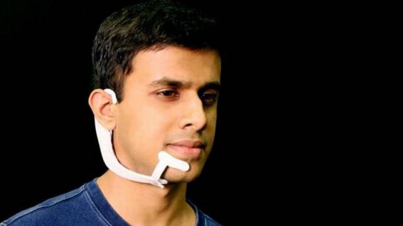 Electrodes in the device pick up neuromuscular signals in the jaw and face that are triggered by internal verbalisations -saying words 'in your head' - but are undetectable to the human eye. (Photo: MIT)