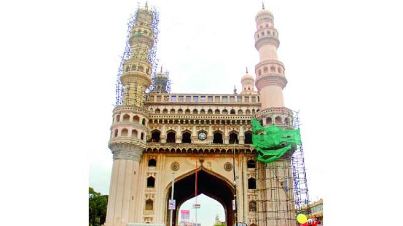 Following the collapse of a portion of the facade of the southwest minaret of Charminar, corporation officials have been in dilemma over the installation of bollards within the first 50 feet.