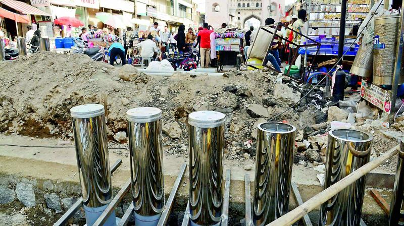 File photo of GHMC authorities installing bollards on the Mecca Masjid side of the Charminar.