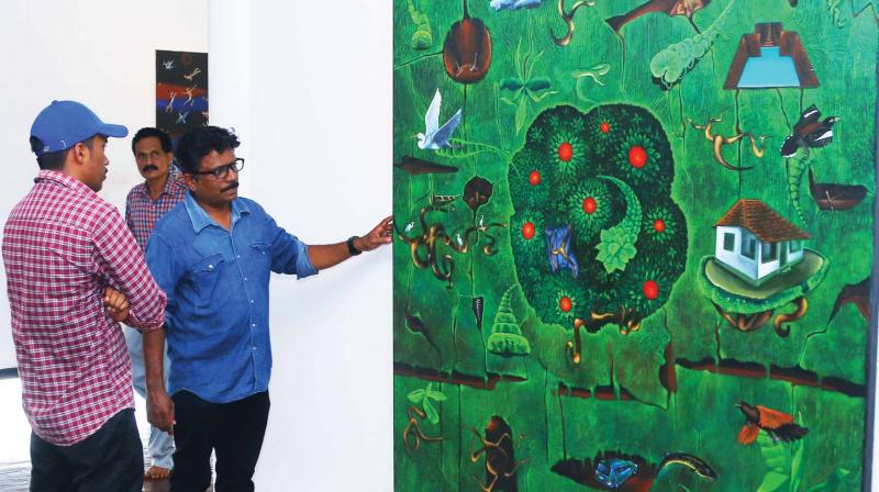 Sudheesh explains his work to a viewer