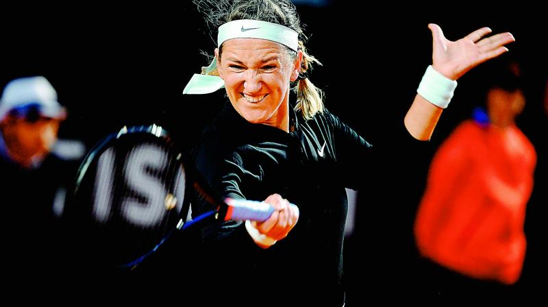 Victoria Azarenka plays a forehand return to Elina Svitolina during their WTA Masters tournament tennis match in Rome on Wednesday. (Photo - AFP)