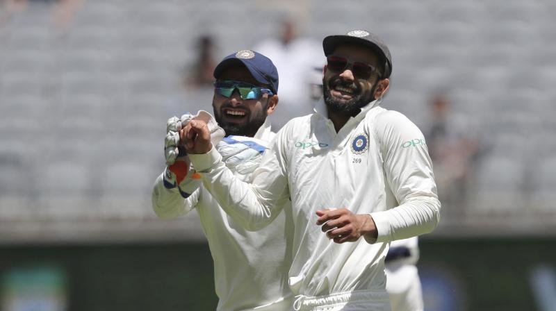 India skipper Virat Kohli maintained his top spot, while young wicketkeeper-batsman Rishabh Pant and pacer Jasprit Bumrah attained their career-best positions in the latest ICC Test rankings. (Photo: AP)