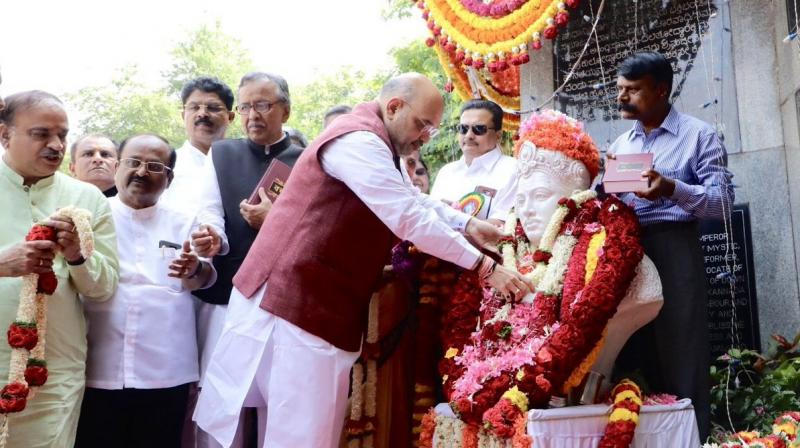 Amit Shah, who is in Karnataka for another round of campaign ahead of the polls, started the day with a visit to a Basaveshwara statue. (Photo: Twitter | @AmitShah)