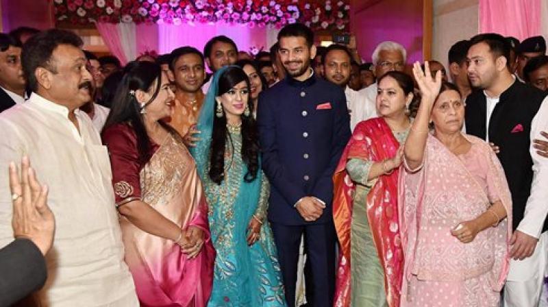 Tej Pratap Yadav with fiancee Aishwarya Rai, granddaughter of former Bihar chief minister Daroga Prasad Rai, during their engagement function in Patna.(Photo; File)