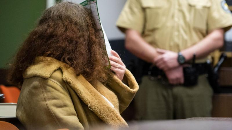 Gabriele P. hides her face in court. (Photo: AP)