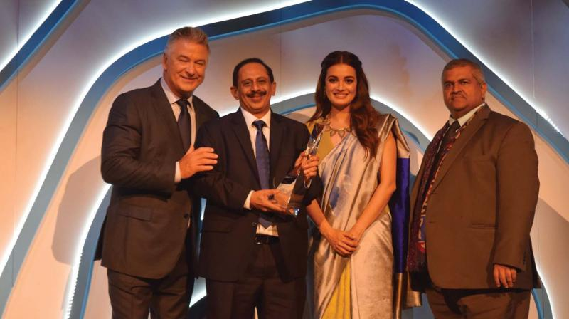 CIAL managing director V. J. Kurian with UN officials after receiving 'Champions of Earth-2018' award.