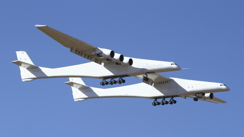 Stratolaunch, a giant six-engine aircraft with the world's longest wingspan , makes its historic first flight from the Mojave Air and Space Port in Mojave, California. (Photo:AP)