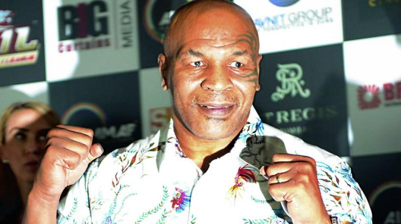 Mike Tyson poses at a promotional event in Mumbai on Friday. (Photo:Rajesh Jadhav)