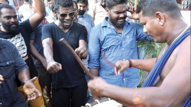 Actor Vinayakan, who won the best actor's award, in a celebration mood along with his neighbors at Kammattipadam colony in Kochi on Tuesday. Vinayakan won the award for his role in the film 'Kammattipadam'.  (Photo: SUNOJ NINAN MATHEW.)