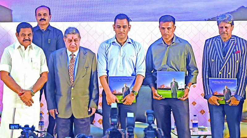 Tamil Nadu chief minister Edappadi K. Palaniswami (left to right), managing director of India Cements N. Srinivasan, M.S. Dhoni, Rahul Dravid and Kapil Dev during the launch of a coffee table book.  (PTI)