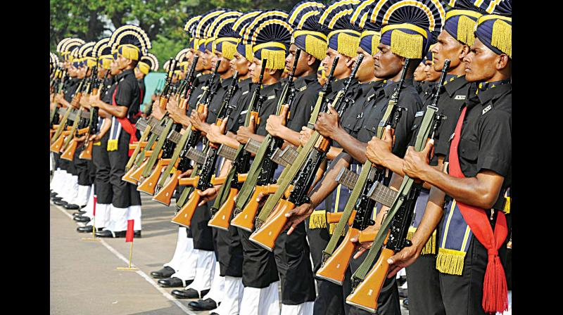 Recruit trainees from No 1 Army Service Corps Training Centre joined the Ranks of the Indian Army and attained status of  a regular soldier at a passing out and attestation parade held at the ASC Centre and College in Bengaluru on Saturday. (Photo: KPN)