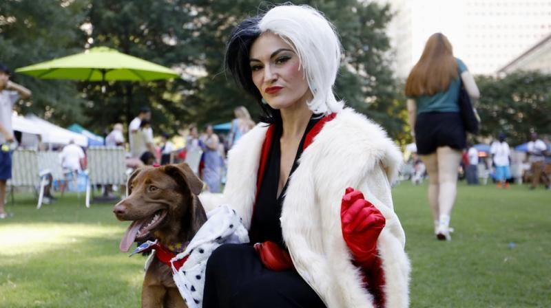 Doggy Con drew hundreds of dog owners and spectators Saturday to an Atlanta park for their own small cosplay convention. (Photo: AP)