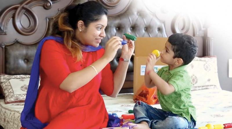 A mother and her son play with toys in this file photograph used for representational purposes only
