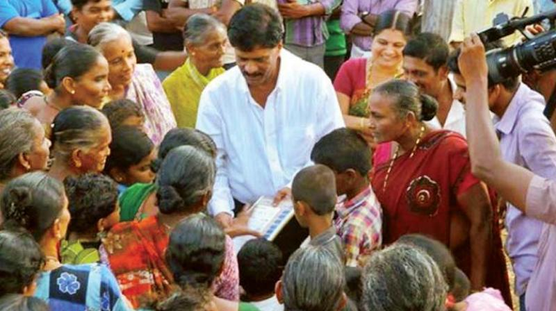 In this file photograph, Kundapura MLA Halady Srinivas Shetty campaigns during a previous election.