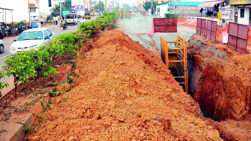 Road in B.V. Nagar dug up during the underground drainage works in Nellore city.