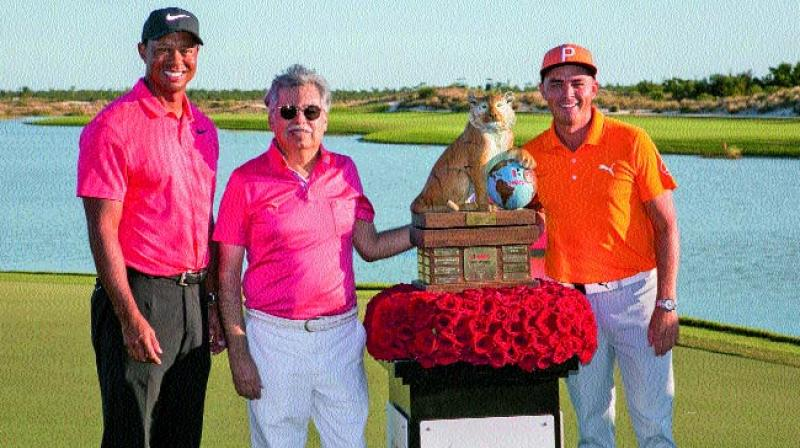 Tiger Woods (from left) and Hero MotoCorp CMD Pawan Munjal pose with the winner of the Hero World Challenge Rickie Fowler in Albany on Sunday.