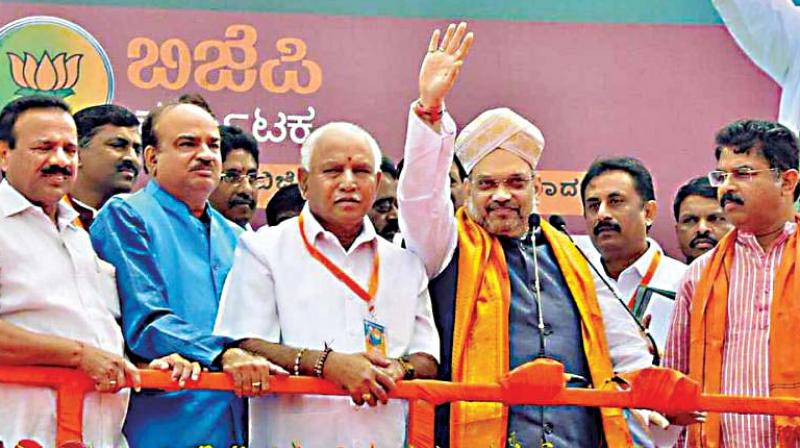 State BJP core committee members with party president Amit Shah during his recent visit to Bengaluru (Photo:  DC)