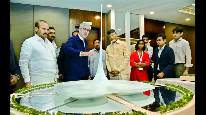 Chief Minister N. Chandrababu Naidu watches the capital's designs at the Amaravati Deep Drive workshop on the second day in Vijayawada on Friday. (Photo: DC)