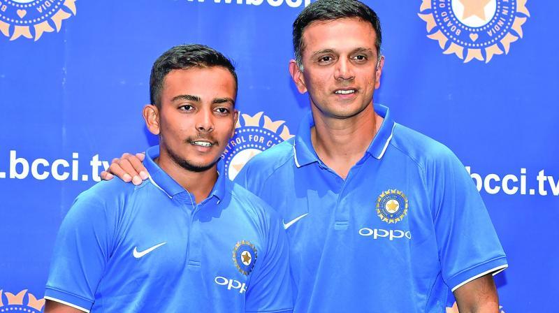 India U-19 skipper Prithvi Shaw and coach Rahul Dravid. (Photo: PTI)