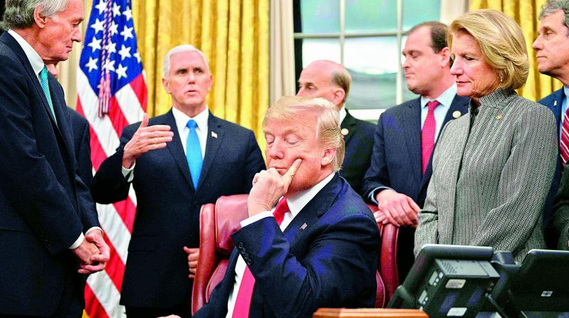 US President Donald Trump (C) with lawmakers at the White House in Washington, DC.