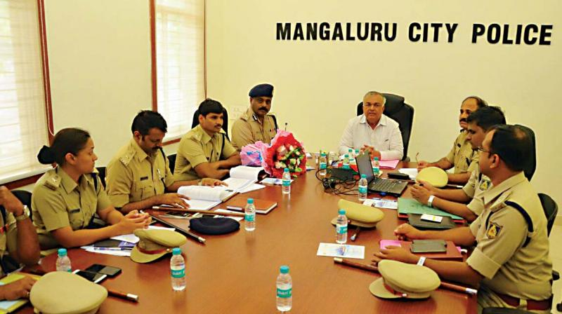 Home Minister Ramalinga Reddy holding a review meeting with police officials in Mangaluru  (Photo:DC)