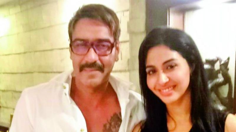 Gayathiri Iyer with Ajay Devgn.