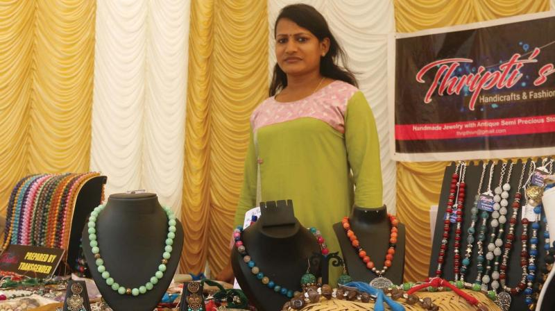 Thripthi Shetty, the first transgender person to register under Handicrafts Development Corporation of Kerala and receive an artisan's ID card from the Union Ministry of Textiles in her stall at Public Office Complex. (Photo:DC)
