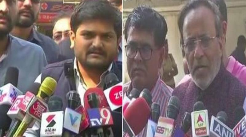 Hardik Patel, Cong leader Arjun Modhwadia met Togadia at a hospital in Ahmedabad where the VHP leader was admitted on Monday in an unconscious state. (Photo: ANI)