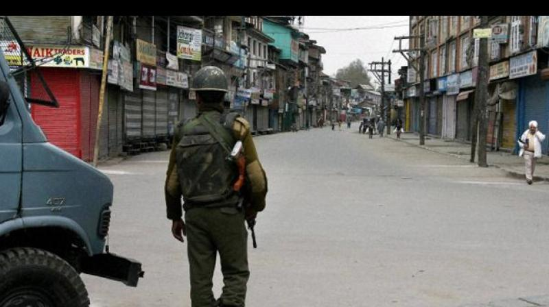 Shops and business establishments remained closed in most parts of Kashmir while public transport was off roads due to the strike. (Photo: PTI)
