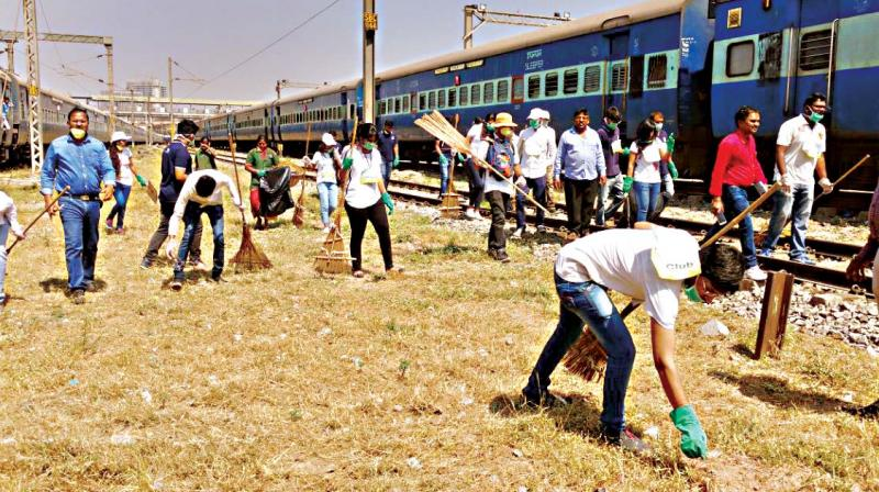 Volunteers from Eco-Watch clean the premises of City Central Railway Station in Bengaluru on Wednesday. (Photo:DC)
