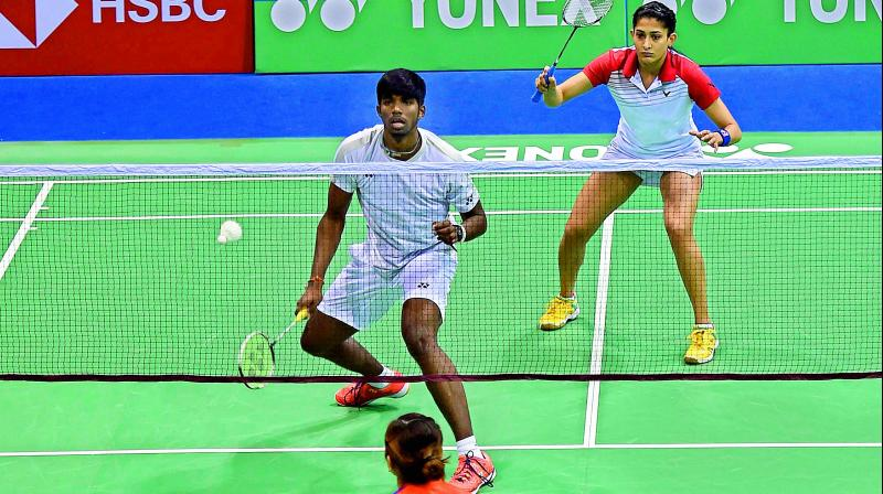 Indians Rankireddy Satwiksairaj and Ashwini Ponnappa in action during their mixed doubles second round match against Malaysia's Tan Kian Meng and Lai Pei Jing at the India Open at Siri Fort Indoor Stadium in New Delhi on Thursday. Satwik-Ashwini won 21-16, 15-21, 23-21. (Photo:PTI)