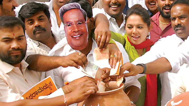 BJP workers protest against Chief Minister Siddaramaiah in Bengaluru on Wednesday