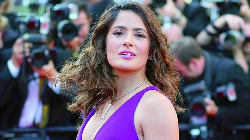 Salma Hayek: Harvey Weinstein threatened to 'break my kneecaps'