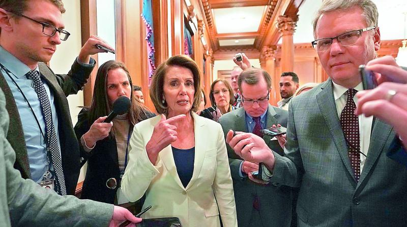 US House Minority Leader Nancy Pelosi speaks to the media after her speech which lasted for more than eight hours. (Photo:AFP)